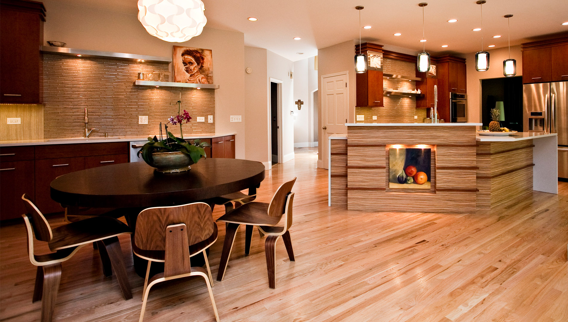 Large elongated kitchen with two distinct areas - cooking and baking.