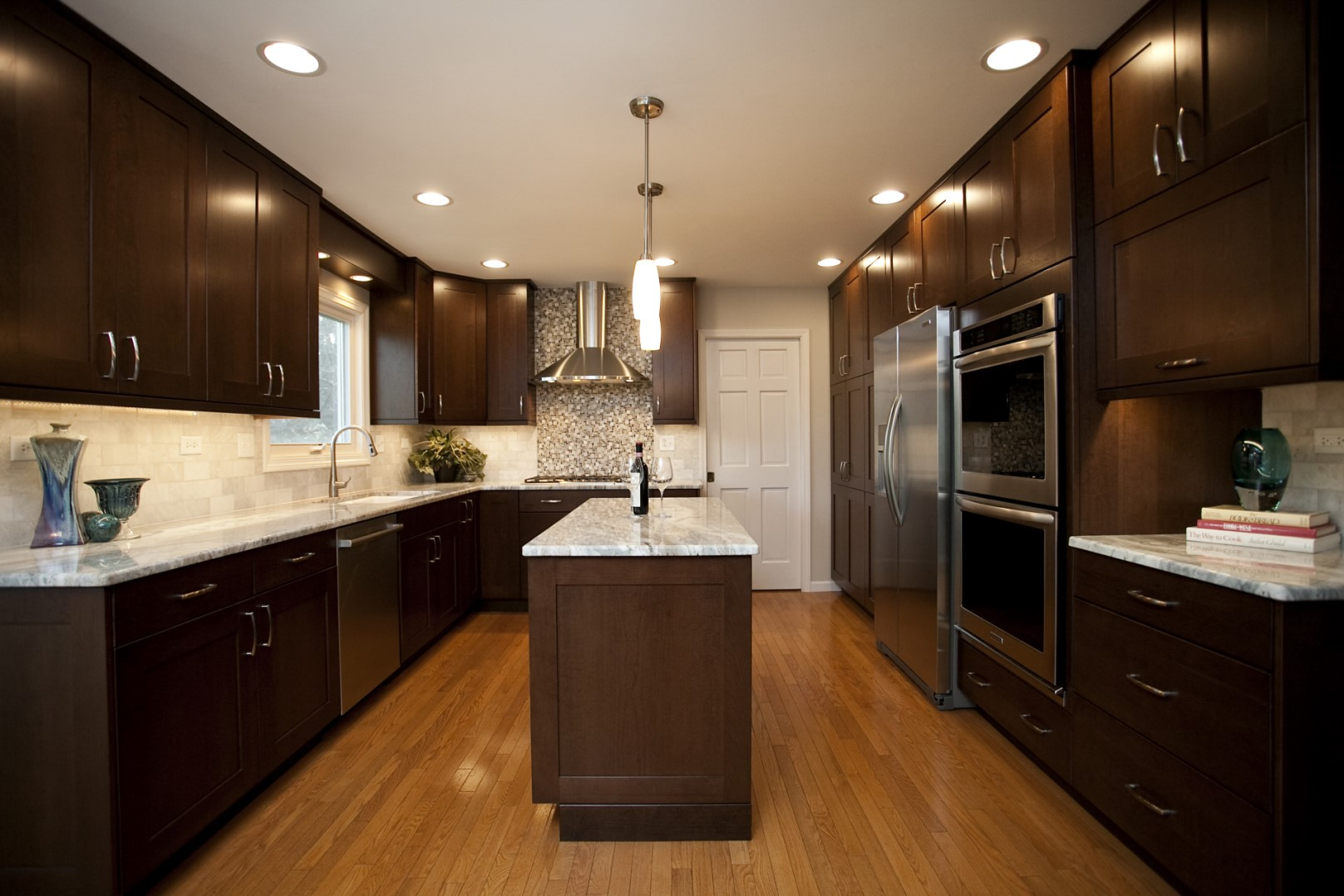 Dark contemporary cabinets with light countertops in a contemporary kitchen
